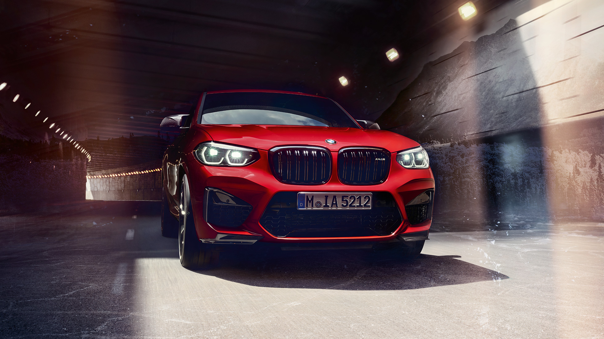 BMW X4 M in Toronto Red metallic, exterior, three-quarter front view.