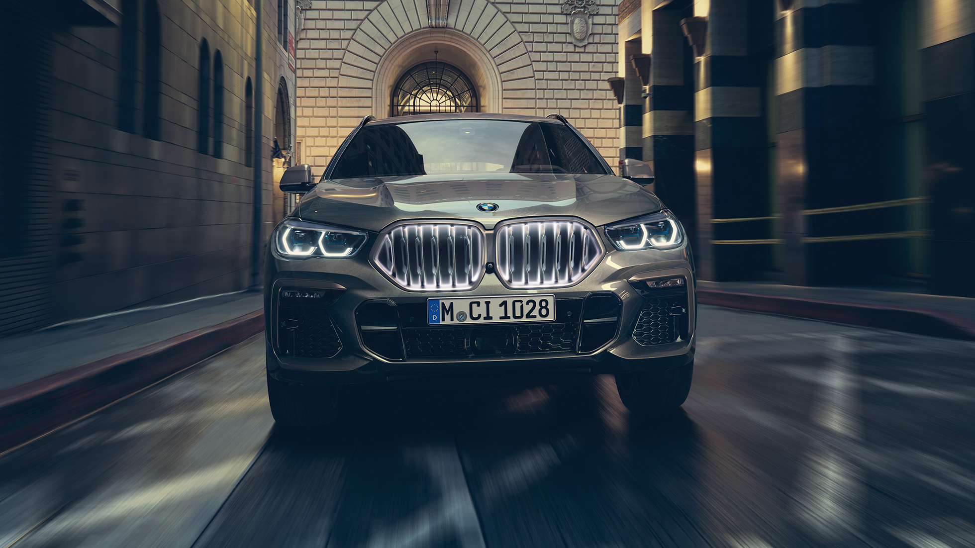 BMW X6 in front view in urban setting.